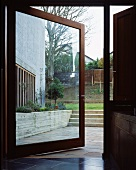 Large glass door leading from kitchen to terrace