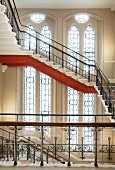 Impressive stairwell with neo-Gothic windows