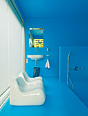 Azure blue bathroom with white plastic chairs in front of window with closed panel blinds