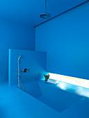 Dive into the blue - azure blue bathroom with sunken bathtub
