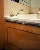 Wood panel with inlay work on bathtub