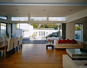 Dining area in living space with open folding terrace door