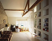 Child's bedroom with brick wall in renovated attic