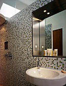 Bathroom with washstand, mirror and mosaic tiles