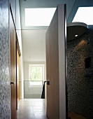 Bathroom with open door and view into stairwell