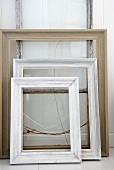 Three picture frames on white surface