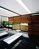 Modern terrace with relaxation area, shower and wheeled couches