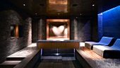 Spa with elegant relaxation area, pool and heart-shaped lighting effect