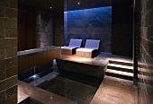 Luxurious spa with relaxation couches and pool