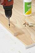 Attaching wooden batten to panel using cordless screwdriver