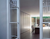 View into dining room with courtyard in background