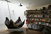 Indirect light from above in round reading corner with animal skin hammock and beanbags