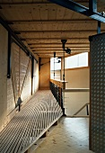 Gallery walkway in contemporary wooden house with steel structure