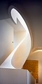 Sculptural element - oval spiral staircase with solid balustrade and view of modern artwork with text motif