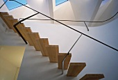 Bottom view of floating staircase & skylight