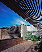 Metal slatted structure as sunshade for building and balcony