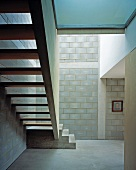 Simple stairwell with concrete staircase and brick walls