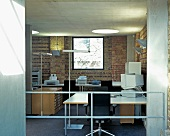 A modern office with a square window and a round skylight