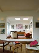 Seating area & doorway to raised living room