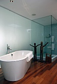 Bathroom with free-standing bathtub, shower & scupltures