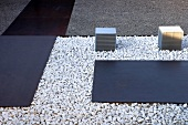 Steel plates bedded on gravel in entrance area