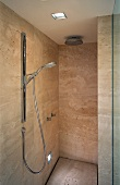 Contemporary-style shower area with marble cladding