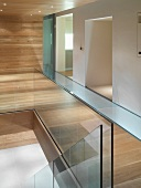 Detail of staircase with glass balustrade in modern hallway