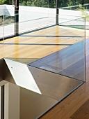 Glass balustrade around aperture in floor