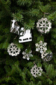 Christmas decorations with snowflake motif hanging on Christmas tree