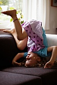 Girl tumbling on sofa