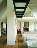 Open-plan, double-height living room