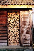 Stacked firewood in shed