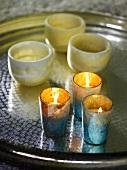 Tea light holders on tray
