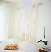 Bedroom with white and cream textiles