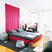 Bed room with pink tapestry and grey bed linen