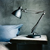 Grey, anglepoise lamp on bedside table