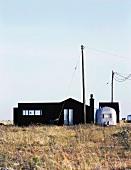House with black facade and metal, retro caravan