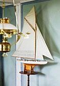 Model yacht and oil lamp