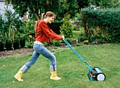 A woman mowing the lawn