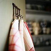 Tea towels hanging on pegs