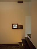Corner of room with steps leading to floor-to-ceiling doorway