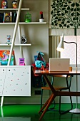 Detail of child's bedroom with fifties-style desk and standard lamp