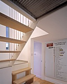 Foyer with modern staircase in apartment block