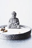 Buddha statue in Zen bowl garden