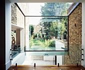 View of garden through glass wall