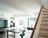 View of open-plan kitchen from staircase