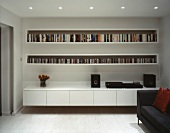 Wall unit with books, CDs and stereo system