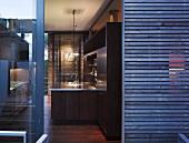 View into dark wood kitchen