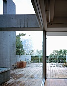 View of terrace from interior through glass wall