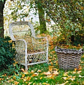 Weathered rattan armchair and basket on lawn